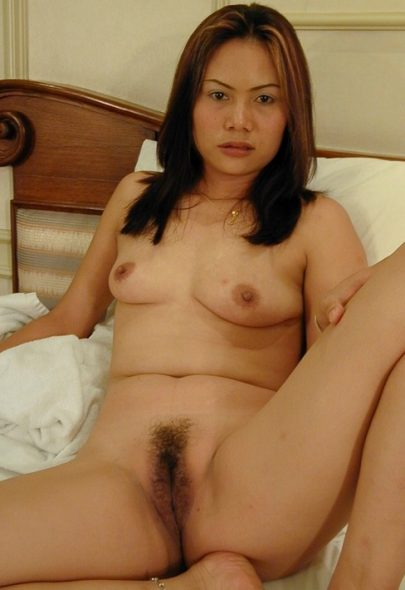 Thai MILF Naked on Bed