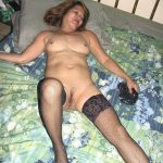 Mature Asian GILF on Bed